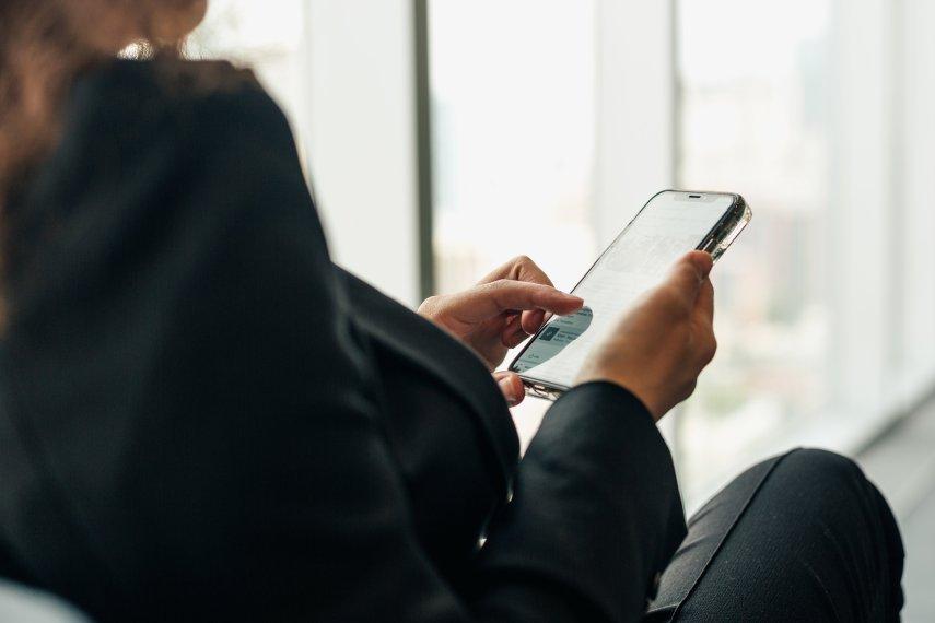 woman-holding-phone-browsing-social-media